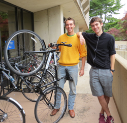Spokespeople president Tristan Cole '13 and Spokespeople mechanic Jules Tamagnan '16 pose with one of the new bicycles available for rent through the library.