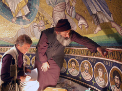 Roberto Nardi, left, and Father Eftimios examine the mosaic of the Transfiguration. Nardi, who specializes in ancient and medieval mosaics, will give an illustrated presentation on his work Monday, April 4, at 4:30 p.m.
