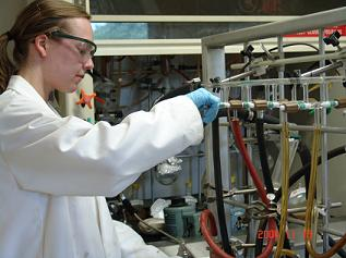 Taryn Campbell ´12 works in a lab, synthesizing compounds.