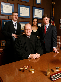 Pictured from left: Tom Giblin '10, the Honorable Robert H. Gardner '82, Aditi Juneja '12 and Steve Strauss '07.