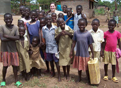 Brigid O´Gorman ´11, center, poses with children during a medical mission to Kaberamaido, Uganda