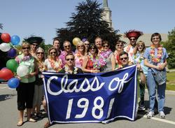 The Class of 1981, celebrating its 30th reunion, pauses for a photo at the start of the parade.