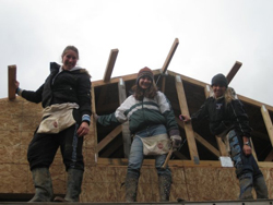 Rita Holak ´10 (left) poses with members of  the College´s chapter of Habitat for Humanity during last year´s build.