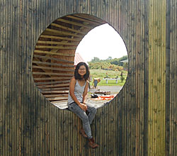 "Clara Euam '12 with ""Attune,"" a large, outdoor sculpture she created during her College-funded internship."