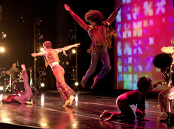 "Raja Kelly '09 (center) and other members of David Dorfman Dance perform ""Prophets of Funk."" (Photo by Lauren Owens.)"