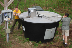 Students turn one of the College's two commercial-sized composting units.