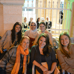 Professor Waed Athamneh and students at the double wedding of her brothers in Irbid, Jordan. Front row (from left): Sarah Huckins '14, Laurel Wolf '14 and Claire Brennan '13. Back row: Nicole Moomjy '12, Professor Waed Athamneh and Molly Vatis '14.
