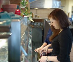 A student helps herself to some Connecticut black currant juice at the new local and regional salad bar in Harris Refectory.