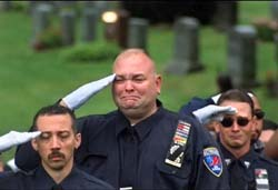 In this scene from the documentary, 'Historicizing 9/11,' first responders honor those who were killed in the 2001 terrorist attacks.