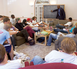 Professor David Canton leads a freshman seminar in a residence house common room.