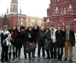 Professor Andrea Lanoux (far left, holding 9-month-old Scarlett), poses with students in Russia.