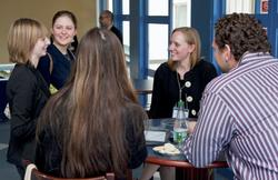 Students talk with Liz Kennedy '04, center, after the Seminar on Success.
