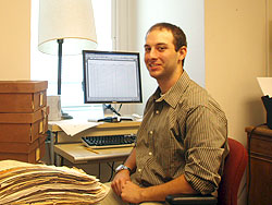 Kevin Hartnett ´10 works with stacks of documents from the 19th century.