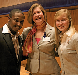 Dean Martha Merrill, center, poses with students after a campus event.