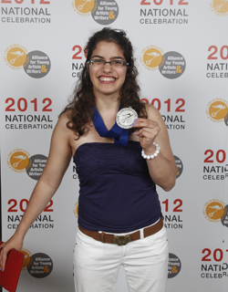 "Marcela Grillo '16 was awarded a National Silver Medal for her short story, ""My Cuba,"" by The Scholastic Art & Writing Awards and the Alliance for Young Artists & Writers. She was honored with the medal June 1 at Carnegie Hall. Photo courtesy of The Alliance for Young Artists & Writers."