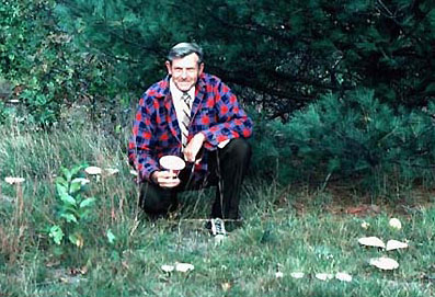 William A. Niering, Lucretia L. Allyn Professor Emeritus of Botany and Research Director of the Connecticut College Arboretum, holding a mushroom