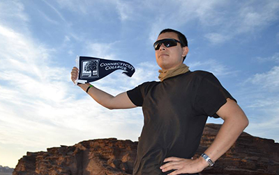 Arabic Studies student with Connecticut College pennant in Jordan