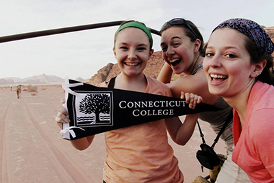 Students in the Jordan Arabic Summer Program with a Connecticut College pennant