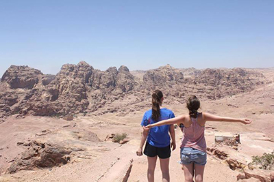 Arabic Studies students enjoy the view after a 2-hour hike up the mountains of Petra, Jordan.