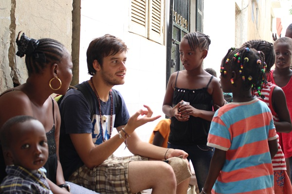 Connecticut College CISLA scholar Juan Pablo Pacheco with children in Senegal
