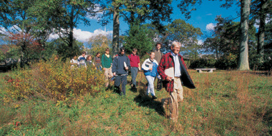 The late Professor William Niering leads students through the Arboretum.