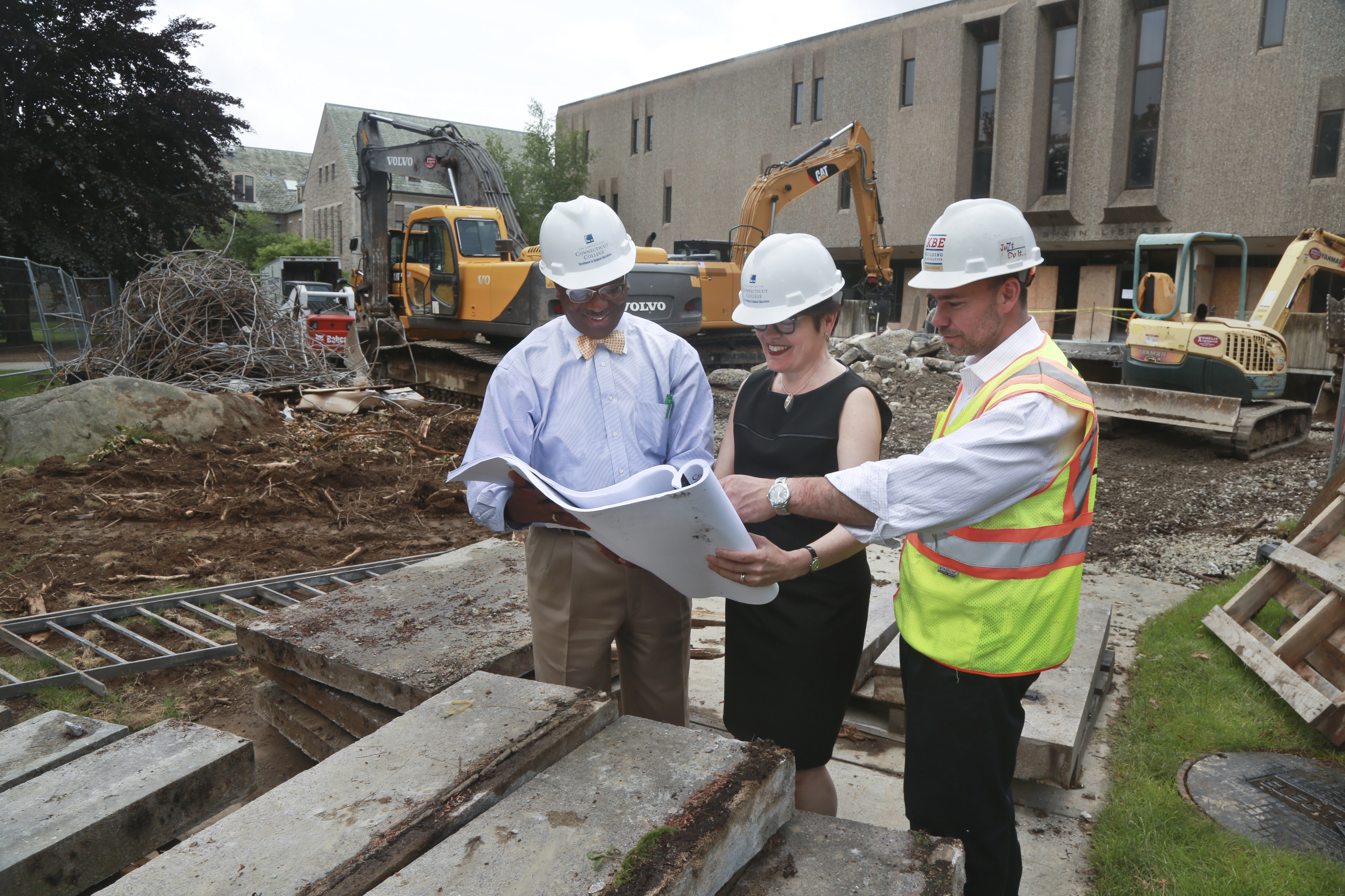 Katherine Bergeron and Ulysses Hammond with construction plans in front of Shain Library.