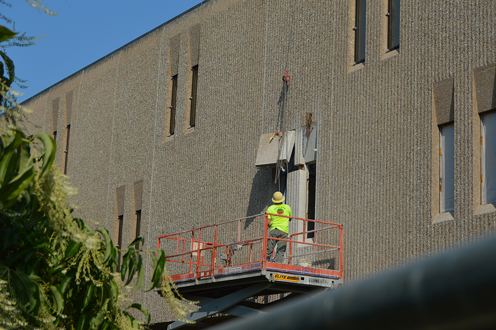 Photo of window being removed as part of Shain Library renovations.