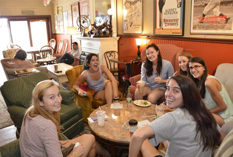 A group of students at Muddy Waters Cafe in New London.